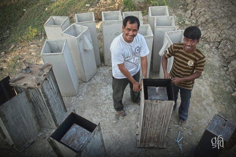biosand-water-filter-men-building.jpg