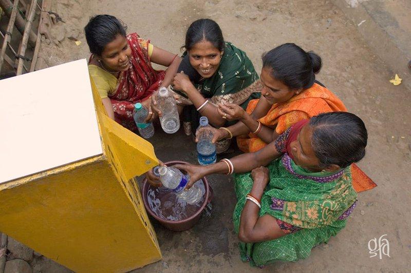biosand-water-filter-women-filling-up-bottles.jpg